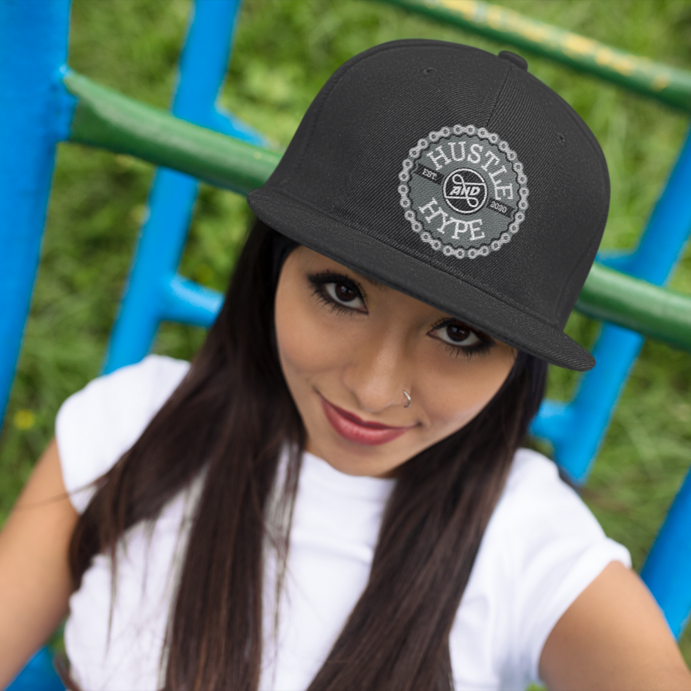 smiling hispanic girl at a park wearing a hat