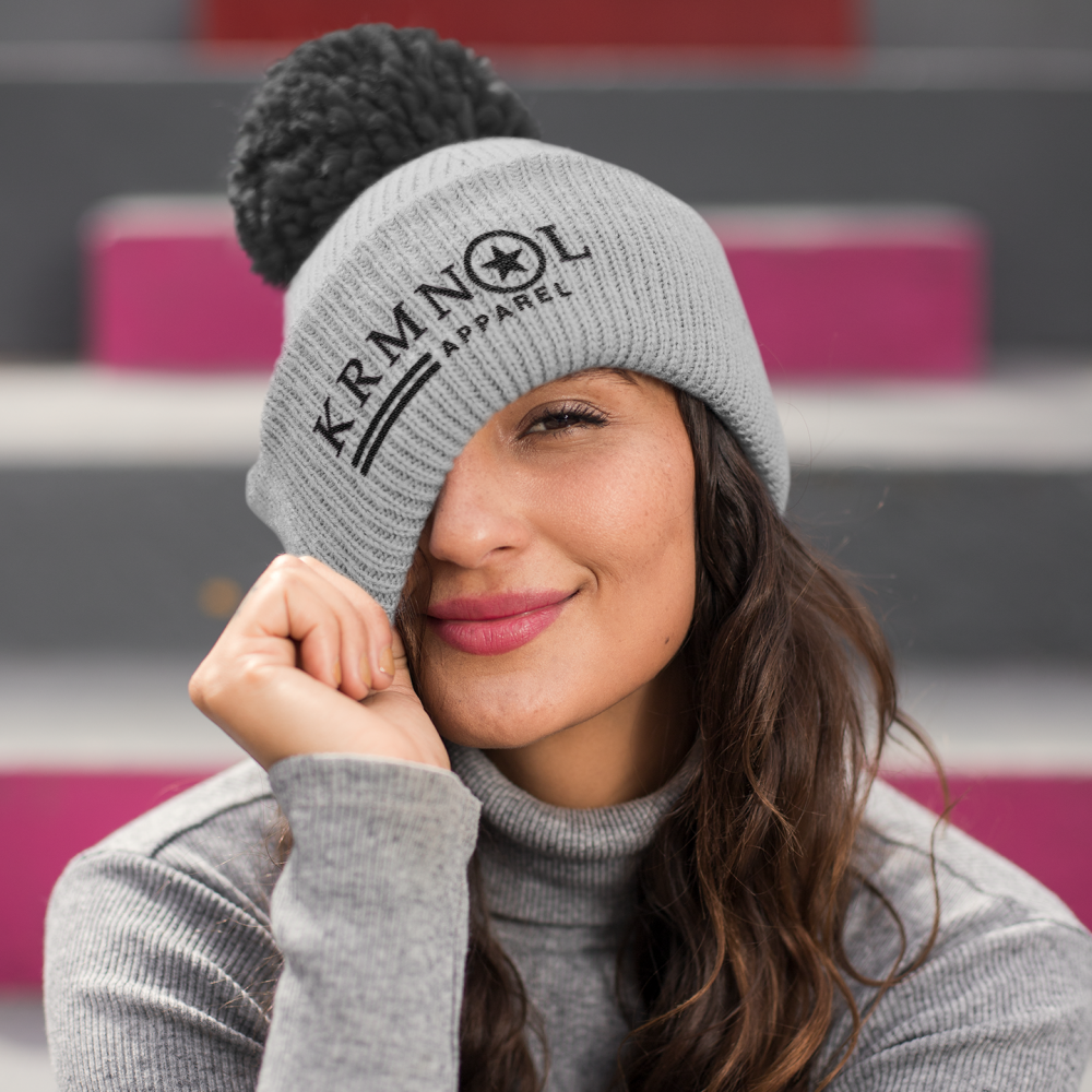 beautiful brunette woman wearing a pom pom beanie
