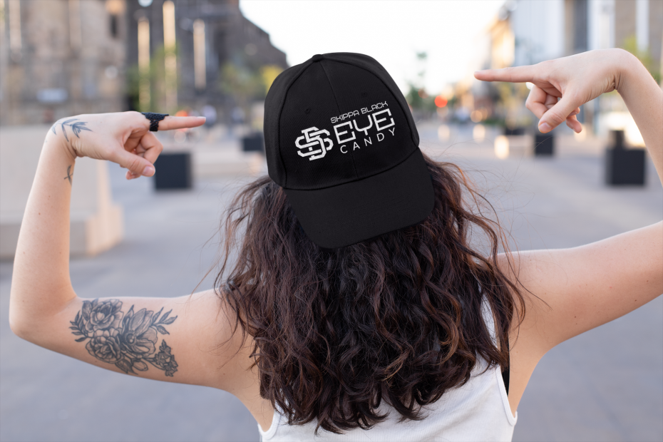 tattooed woman in the street pointing at her dad hat