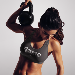 fit woman lifting a kettlebell in a sports bra