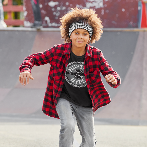cool kid skateboarding in a t-shirt