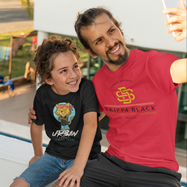 man taking a selfie with his kid in a t-shirt